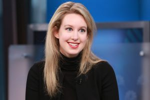 US judge drops some charges against Theranos's Holmes, leaves wire fraud