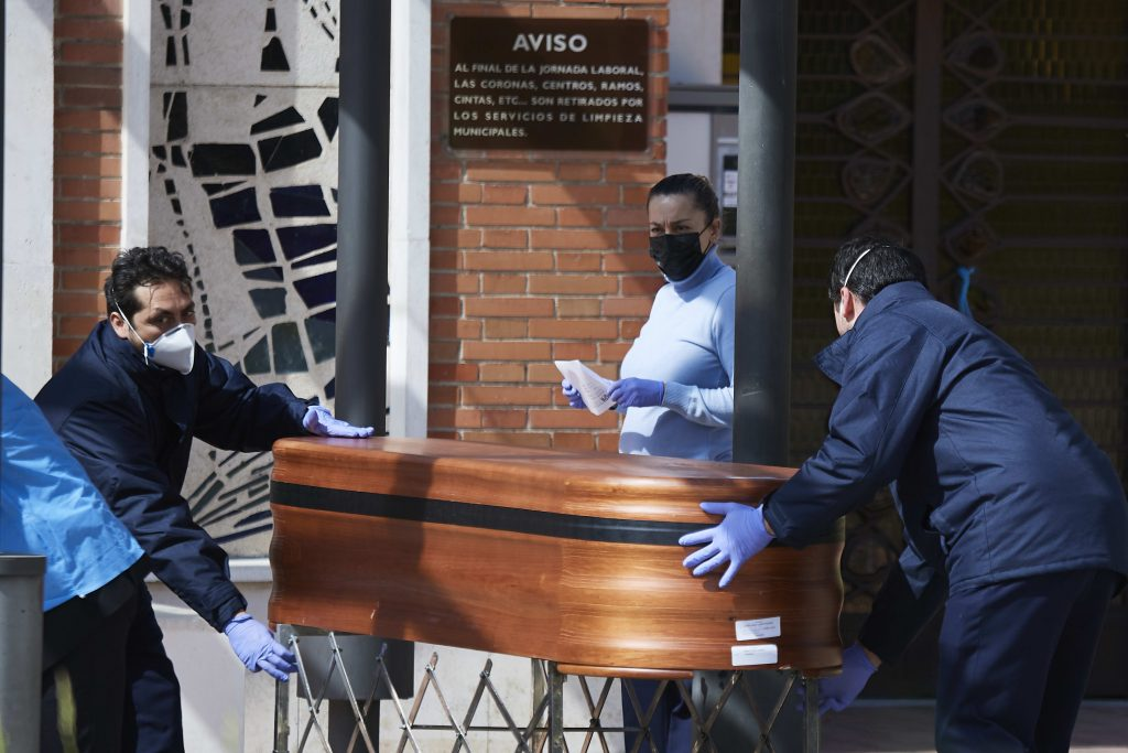 Shellshocked Spain reports record new deaths